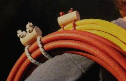 Simple to make cord wraps (from lenths of old bungie) that could be used for hoses or extension cords