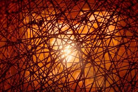Stock image of 'Braided surface with light in the background'