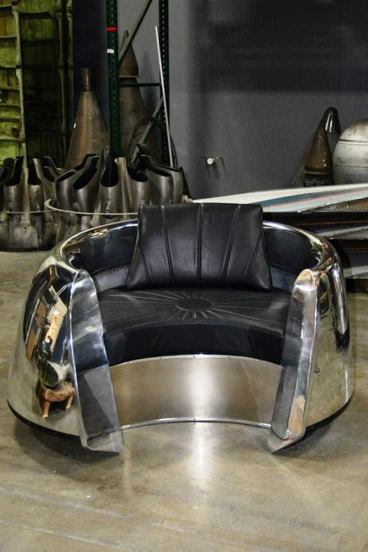 This beautiful custom piece of aviation furniture is a chair is made from a  DC9 inlet
