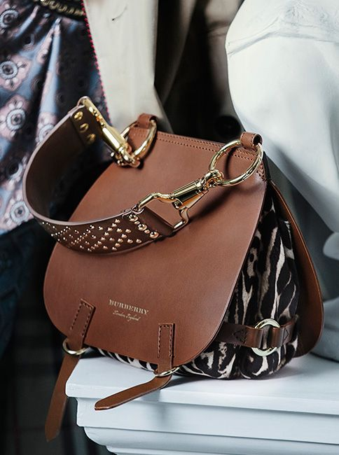 The Bridle Bag from the Burberry September runway collection. An equestrian style leather satchel featuring metallic studs and clasps.