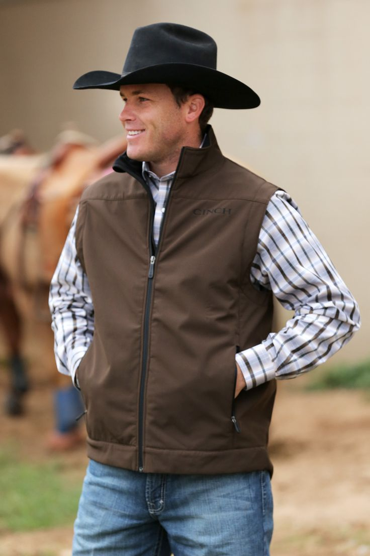 Warm it up, cowboy. You'll get warmth and ease of movement with this men's bonded vest by Cinch. Featuring embroidered logos, zip front, roomy zip pockets and concealed carry pockets with a hook & loo