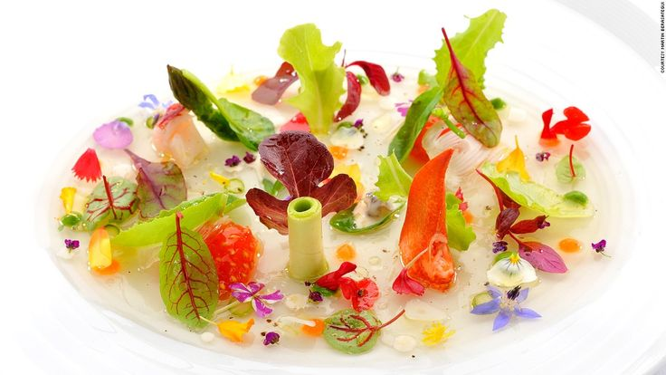 It's not just a salad. It's a carefully arranged edible garden. Fresh leaves and peppered flowers come together with rich lobster and cream of lettuce on a lake of jellied tomato juice.