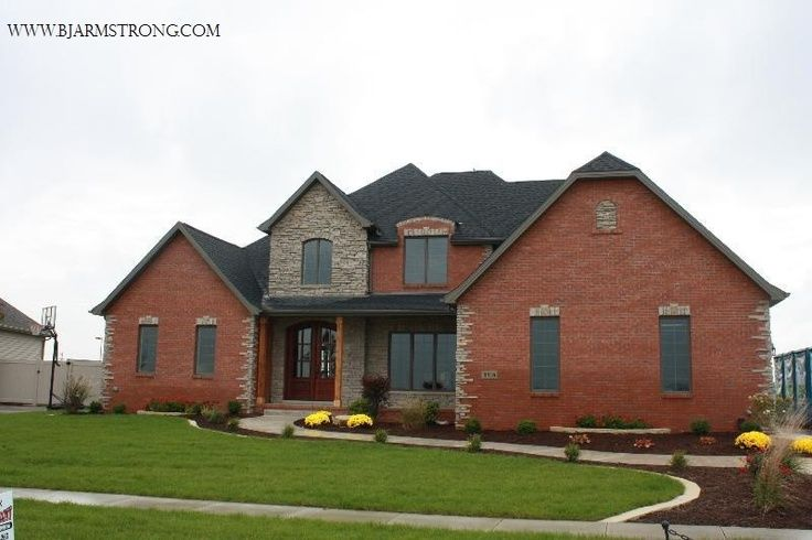 Red brick houses with rock brick and stone custom home for Exterior home accents