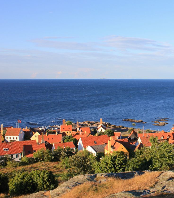 """This beautiful view of the city of Gudhjem on the danish island Bornholm is also the name of the famous Danish piece of dark bread with smoked herring, egg yolks, onions and radishes called """"Sol over Gudhjem"""""""
