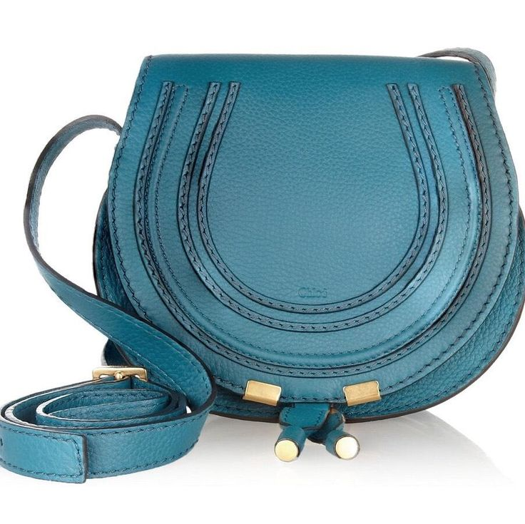 Chlo Mini Marcie Laguna Blue Chloe Cross Body Bag. Get the trendiest Cross Body Bag of the season! The Chlo Mini Marcie Laguna Blue Chloe Cross Body Bag is a top 10 member favorite on Tradesy. Save on yours before they are sold out!