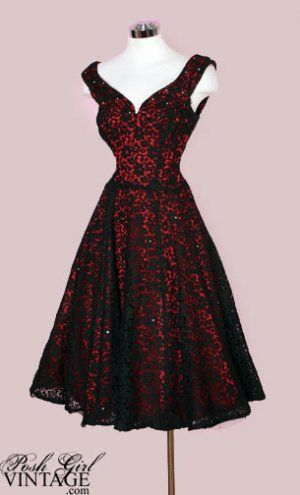 1950s Red With Black Lace Overlay Dress. Rich red satin with a sheer black lace overlay that's sprinkled with crystal rhinestones.