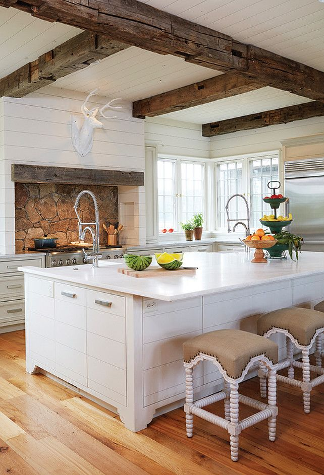 Country Kitchen with Wooden Beam Ceiling. Country kitchen boasts white plank ceiling dotted with rustic wood beams. #CountryKitchen #BeamCeiling   Birmingham Home and Garden