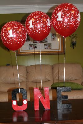 Mickey Mouse Party ~ Decoration ~ 'ONE' Letter Blocks (from Michael's)     Spray paint black the O top half black and bottom half red and paint two white circles for the buttons. Spray paint the N red. Spray paint the E black. (Optional: And you can hang balloons on them)