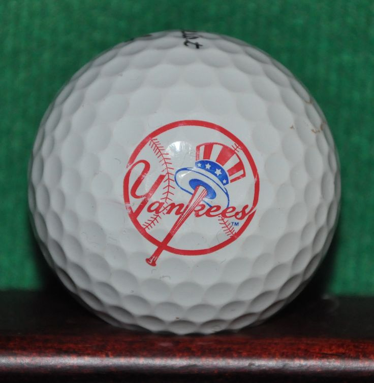 New York Yankees MLB logo golf ball. Titleist Pro V1 Evidence of play is visible on the ball (pictured). Light chipping to the logo. The ball pictured is the ball for sale.