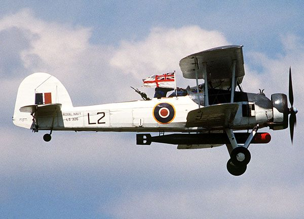 Fairey Swordfish. It was so slow (139mph top speed) that the Bismarck's fire control could not calculate the AA guns. It also flew so low many of the AA guns could not angle low enough to hit it. It helped sink the Bismarck and was in service until the end of WW2.