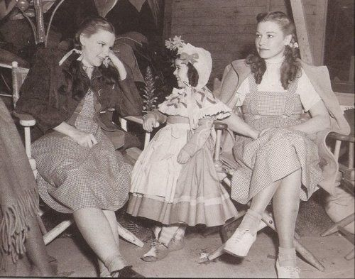 Judy visits with an extra (Munchkin) & Judy's stand in On the set of The Wizard of Oz