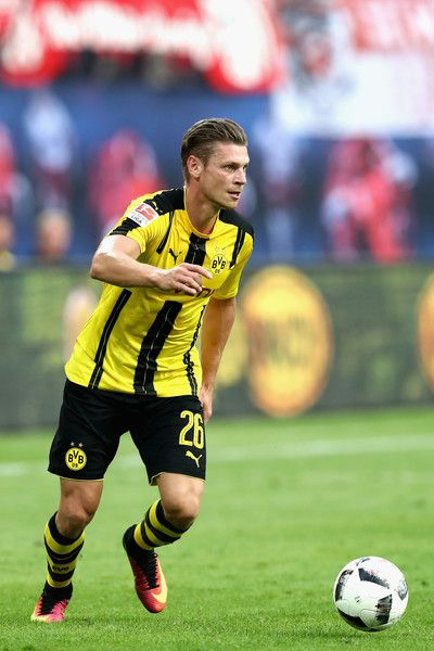 Lukasz Piszczek of Dortmund runs with the ball during the Bundesliga match between RB Leipzig and Borussia Dortmund at Red Bull Arena on September 10, 2016 in Leipzig, Germany.