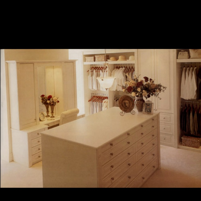 nice size and layout.  Like the built in dresser. corian top?  just enough details
