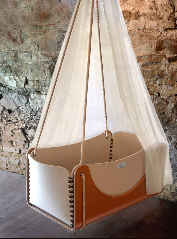 """Cradles by Woodly [In the pic is """"Roll"""", a suspended cradle that swings and bounces, allowing your baby to sleep easier. A birch shell holds a padded nest in pure wool felt for a child's total comfort.] 