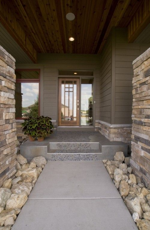 A path of river rock in the porch looks really good!