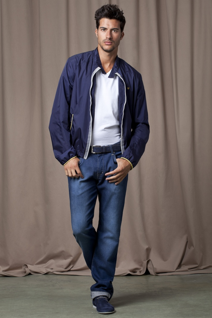 Blue jacket and jeans with white t-shirt and chukka boots