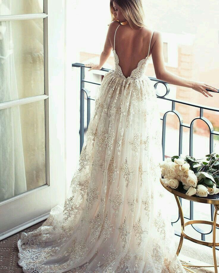 LOVE the spaghetti strap going into scalloped lace back. Delicate and beautiful, and different.