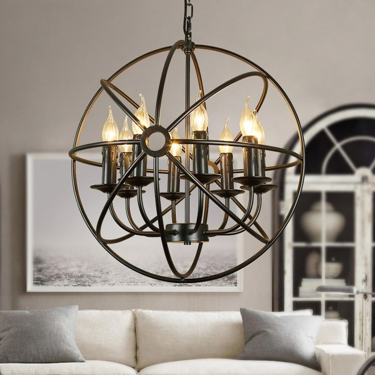 Industrial Black Metal Orb Cage Chain Suspended Candelabra Chandelier, adding lighting excellence in dining or living spaces.
