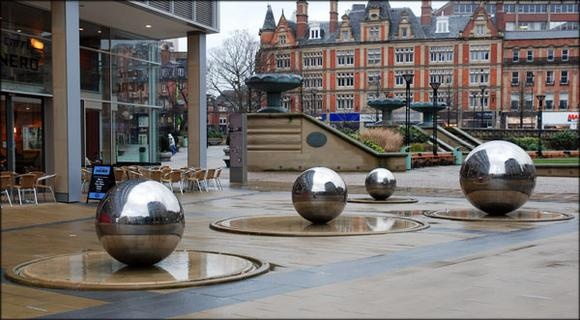 Outsized Victorian gazing balls in an urban plaza