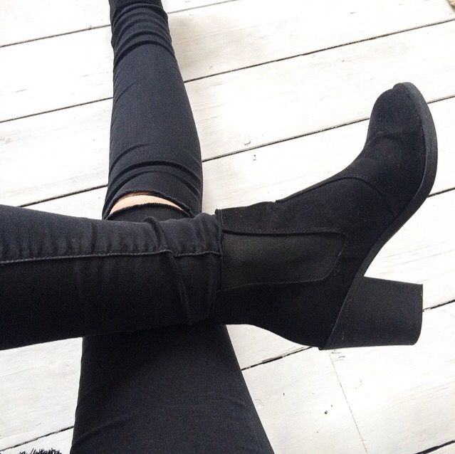 Love these black boots with black ripped jeans i love it because black goes with everything.