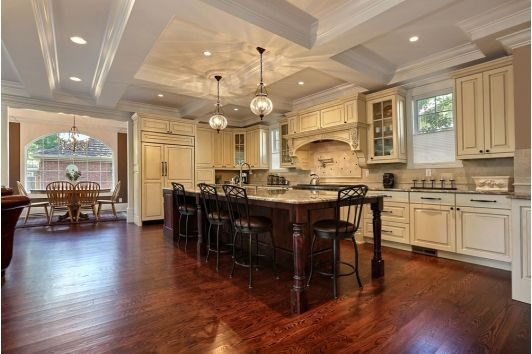 Large kitchen with seating surrounding the island for dining and entertaining.
