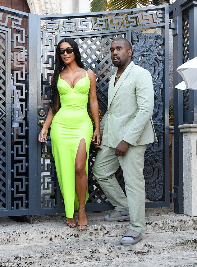 eea8ea0e22d26 Bizarre choice  Kanye West couldn t help but draw in attention from his  fans as he sported Yeezy slides with his mint suit to 2 Chainz  wedding in  Miami on ...