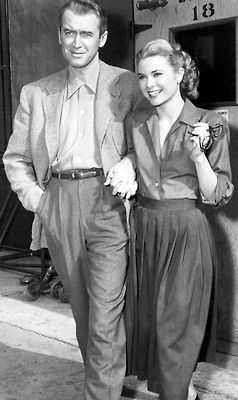 James Stewart and Grace Kelly on the film set of 'Rear Window', directed by Alfred Hitchcock for Paramount Pictures, 1954