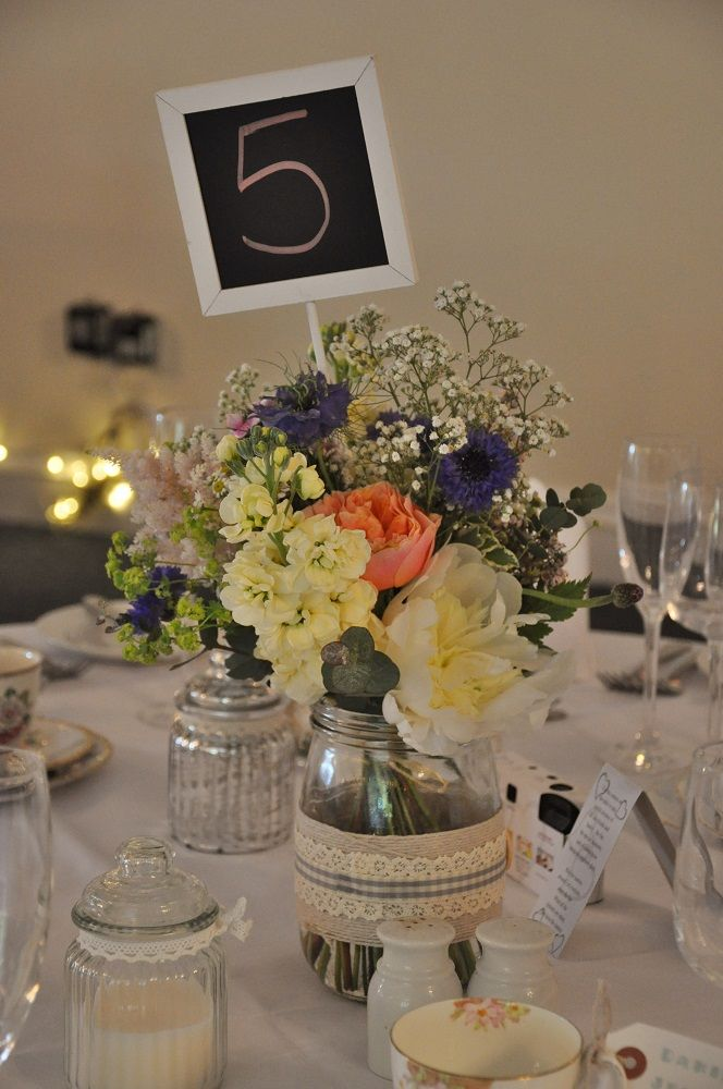 Gallery: Country Garden | Helen Jane Floristry - simple flower filled jars make great table centres