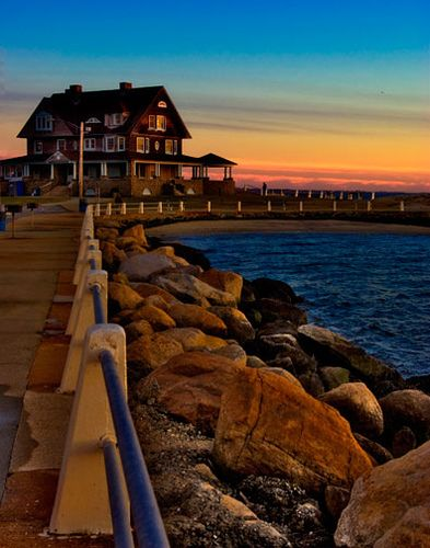 Sunset meets the beach house at Eastern Point, Groton, Connecticut....I LOVE THIS BEACH!! Spent many, many summer days & nights sitting on those rocks.