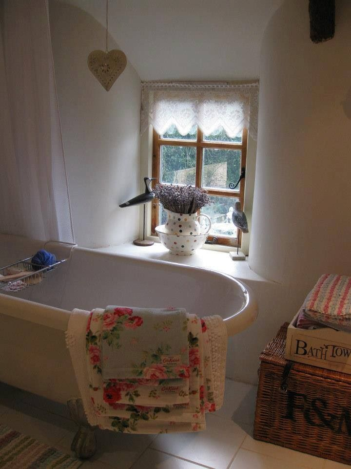 A tad twee for my taste but I love the bath under the little window and the wicker hamper. Nice feel to this bathroom.