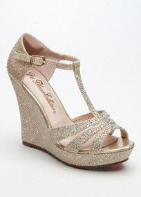"""You will light up the night in these dazzling wedge sandals!  Wedge T-strap sandal is embellished with glitter.  Buckle closure. Available in Champagne and Silver.  Heel height: 4 3/4"""".  Imported."""