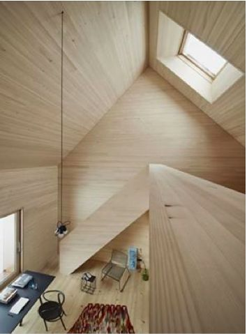Because of the texture of the wood, It extend the perspective. It makes the whole room looks bigger. Furthermore, because of the color of the wood, the room looks not quiet dark, though there are only two small windows there.