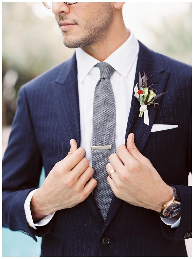 Groom style: Modern navy pinstripe suit by J.Crew with a gray tie. Image by Gianny Campos Photography.