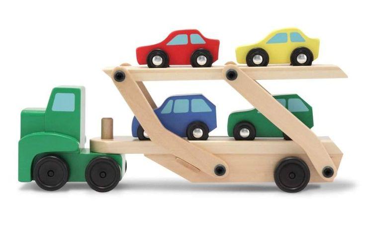 Dřevěný nákladní kamion se 4 autíčky - Transport aut.Výborná hračka pro děti od 3 let.  Kamion, návěs i auta jsou vyrobeny z tvrdého masivního dřeva. Dvoupatrová plošina pro auta se dá sklopit tak, aby auta mohla najet a zase sjet z rampy.  Tahač a návěs se dají odpojit.   Pestré a kontrastní barvy stimulují zrakové schopnosti dítěte.  Rozvíjí kreativní schopnosti a fantazii dítěte.  Příznivě působí na rozvoj motoriky. Dřevěný kamion pro přepravu aut. Dřevěný kamion pro přepravu aut + 4…