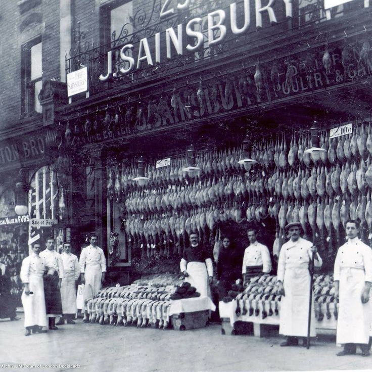 Sainsbury's Woking - Christmas display, c. 1920. (Imagine with today's Elf & Safety Reg's hanging loads of dead birds and animals outside your shop today!)