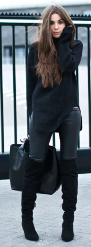 Cindy Van Der Heyden looks sophisticated and stylish in leather leggings and a woollen pullover worn with over the knee boots.  Brands not specified.