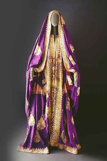 Unlike the other, this seems to be composed of two pieces, one draped over the head and the other worn around the body.