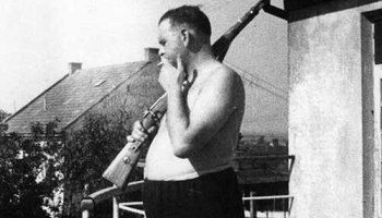 """Camp Commandant Amon Goeth, infamous from the movie """"Schindler's List"""", standing on his balcony preparing to shoot prisoners, 1943"""
