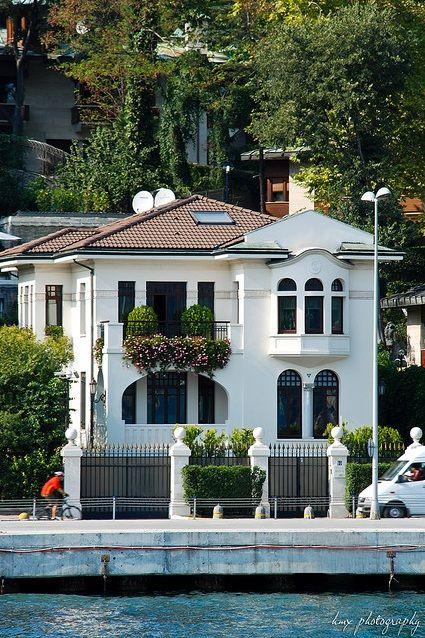 "Yali means ""seashore, beach"" & is a house or mansion constructed waterside  in Istanbul, Turkey, built with an architectural concept that takes into account the characteristics of the coastal location. The term ""yalı"" is used primarily to denote the 620 waterside residences, mostly dating from the 19th century, sprinkled along the Bosphorus in Istanbul.  Finely worked wood was the predominant construction material chosen for yalıs, as in traditional Turkish houses."