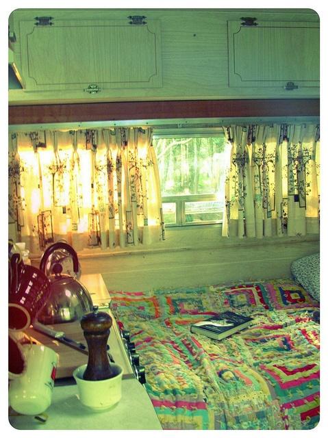 cuddle up inside the Winnebago showing a user friendly kitchenette, via Flickr.