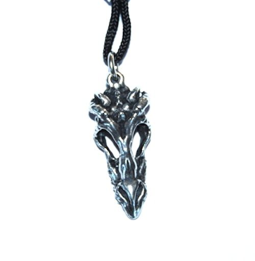 Dragon's Skull Pendant – Celtic Pewter Jewellery. This Dragon Skull, sculpted by Jason Bakutis, was inspired by the legends and games that involved dragons. His superb almost magical sculpting skill make one of his pendants a treasure to possess.