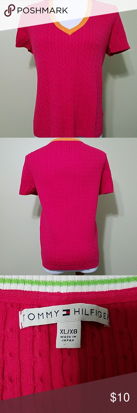 Tommy Hilfiger v-neck hot pink sweater Tommy Hilfiger v-neck hot pink sweater with orange and white trim around neck line. In great used condition.  Length is about 23 inches.  Bust is about 40 inches.  Made of 87% cotton, 11% nylon, and 2% spandex. Tommy Hilfiger Sweaters V-Necks