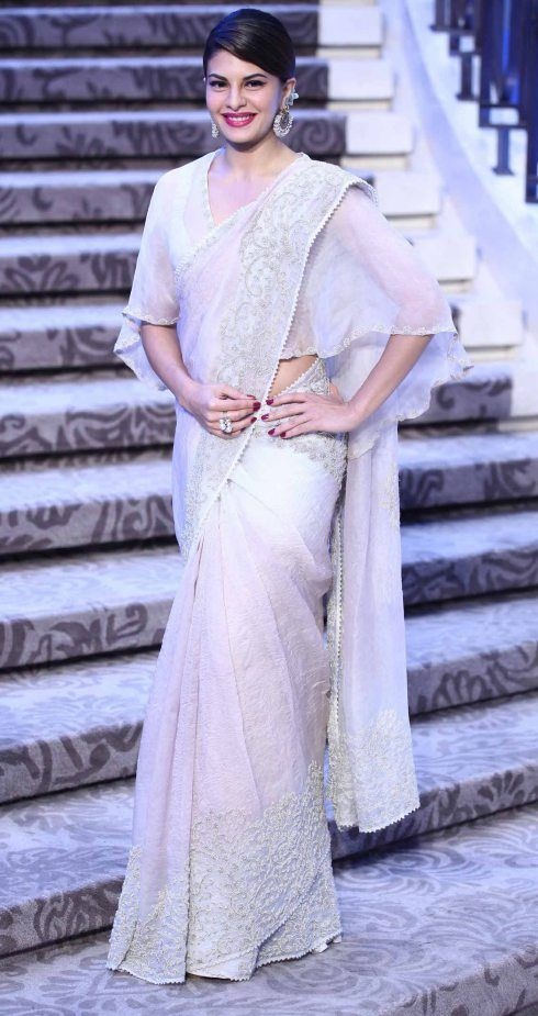 Sari by Anamika Khanna | Ivory embroidered classic sari with cape blouse | Lakme…