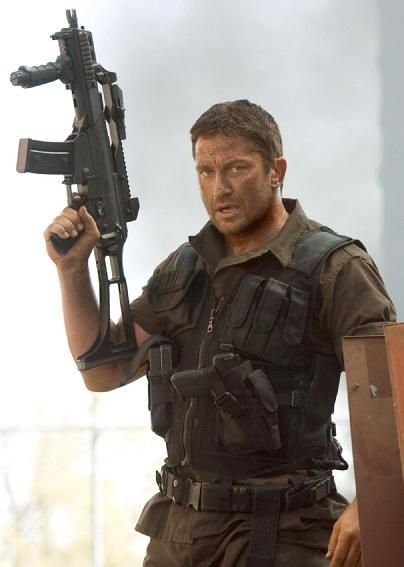 All I want for Christmas.is Gerard Butler with a gun :) Heart Pounding | tattoos picture army tattoos