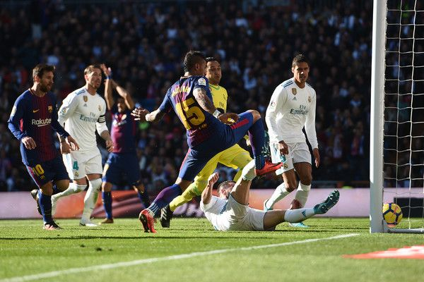 Paulinho of FC Barcelona is fouled by Dani Carvajal of Real Madrid during the La Liga match between Real Madrid and Barcelona at Estadio Santiago Bernabeu on December 23, 2017 in Madrid, Spain.