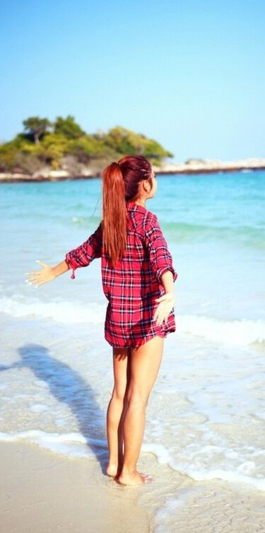 (Open rp with ari/pretend her hair is brown)I stand by the water about ankle deep. I smiled as I looked out at the crystal blue water. I took of my flannel shirt revealing a black bikini. I got further out into the water, my legs turned into a mermaid tail. I smiled as i swum around for a while , and a bit later I swim back to the shore and I walk over to my blue towel I layed in the sand and I saw you sitting on it and you said...(guy)