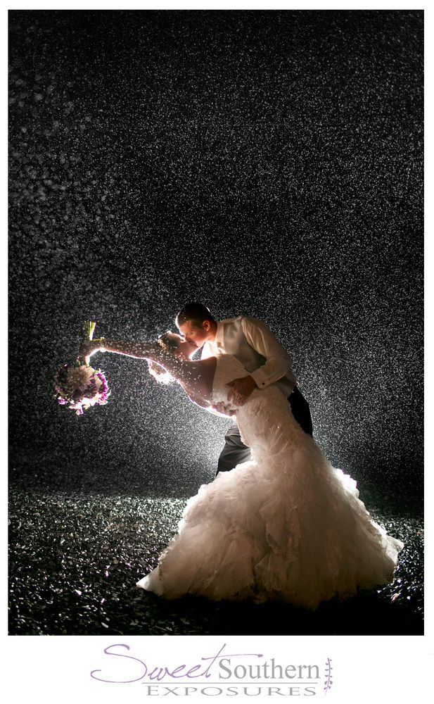 Rain on your wedding day can be pesky, but it looks so darn romantic!