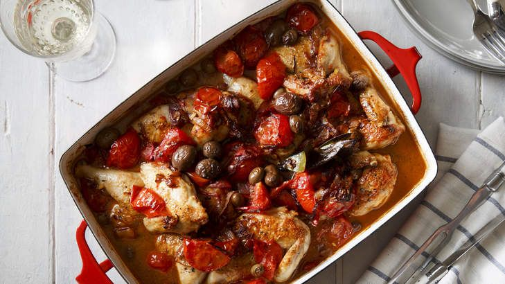 Suitable for a mid-week dinner or easy entertaining: Karen Martini's baked chicken with tomato, sherry, fennel seeds, bay and olives.