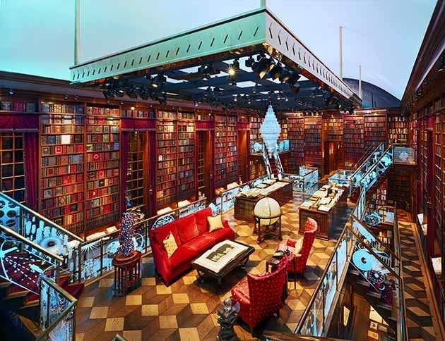 This goes beyond dream house into house I can't even dream of. An amazing personal library if I've ever seen one...