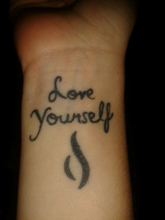"My ""love yourself"" tattoo that is on my other wrist with the N.E.D.A. Symbol. Again facing myself as a reminder :)"